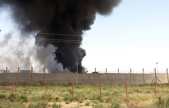 Smoke rises from the the Baiji oil refinery in northern Iraq on June 19
