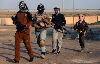 Masked Sunni fighters in Iraq