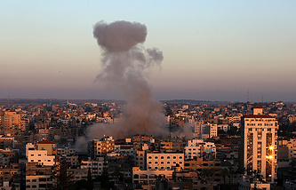 A cloud of smoke rises after an Israeli attack on Gaza City, 11 July 2014