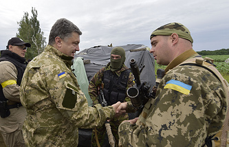 Ukrainian President Petro Poroshenko (left) talks to  a soldier in Sloviansk