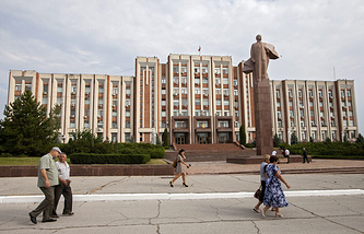 Citizens walk past the Transnistrian Government building