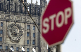 A stop sign seen in front of Russian Foreign Ministry building in Moscow