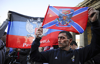 People carry flags of the self-proclaimed entities of eastern Ukraine at a demonstration in Russia