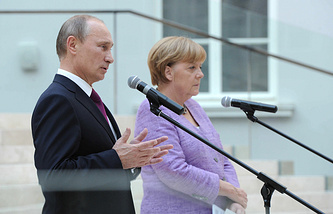Vladimir Putin and Angela Merkel. Archive