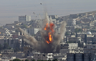Smoke rise after US-led coalition airstrike on Kobane, Syria