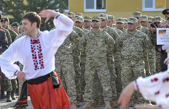 A Ukrainian man wearing national dress dances during the opening ceremony of NATO military drills in Ukraine