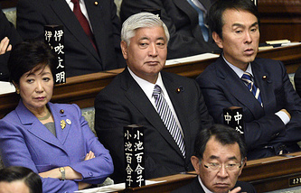 Gen Nakatani (centre) at the Lower House of Parliament in Tokyo