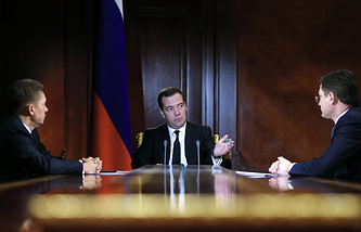 Russian PM Dmitry Medvedev (center), Gazprom CEO Alexey Miller (left) and Energy Minister Alexander Novak (right)