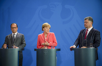 French President Francois Hollande, German Chancellor Angela Merkel  and Ukraine's President Petro Poroshenko