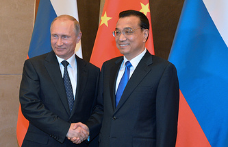 Russian President Vladimir Putin and Premier of the Chinese State Council Li Keqiang
