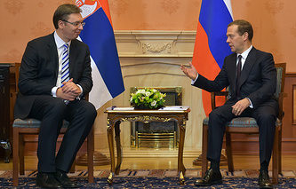 Serbia's Prime Minister Aleksandar Vucic (left) and his Russian counterpart Dmitry Medvedev
