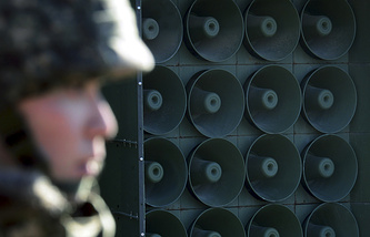 South Korean soldier standing near the loudspeakers near the border area between South Korea and North Korea