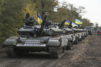Ukrainian servicemen prepare their tanks to withdraw not far of Mariupol, Donetsk region, Ukraine