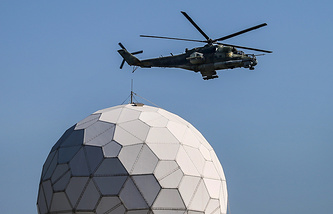 A miltiary helicopter above the Russian air base in Syria