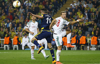 Fenerbahce's Robin van Persie and Lokomotiv Moscow's Jan Durica seen during soccer match in Istanbul