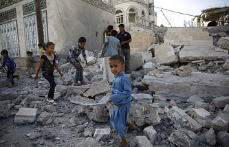 Children play amid the rubble of a house destroyed by a Saudi-led airstrike in Sanaa, Yemen
