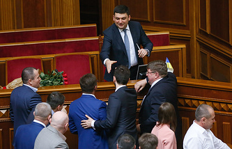 Lawmakers congratulating newly elected Ukrainian Prime Minister Volodymyr Groysman during a session of Ukrainian Parliament in Kiev, Ukraine
