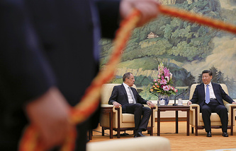 Russian Foreign Minister Sergey Lavrov and Chinese President Xi Jinping