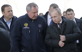 Vladimir Putin, Dmitry Rogozin and Igor Komarov (right to left)