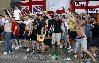 English supporters chant slogans as they clash with Russian supporters