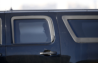 John Kerry seen in a car during his previous visit to Moscow