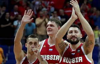 Russian team players greet fans after defeating Serbia