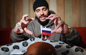 Russian hip hop star Timati during presentation of the 'presidential burger'