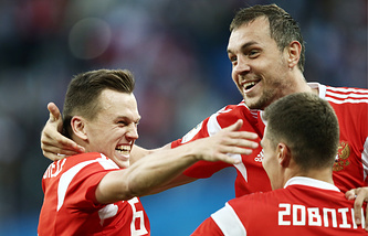 Russia's Denis Cheryshev, Artyom Dzyuba, and Roman Zobnin (L-R) celebrate scoring in the 2018 FIFA World Cup Group A Round 2 football match against Egypt at St Petersburg Stadium