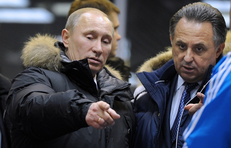 Russia's President Vladimir Putin and Russia's Sports Minister Vitaly Mutko