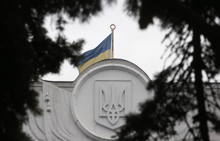 Ukrainian national flag on top of the Verkhovna Rada building