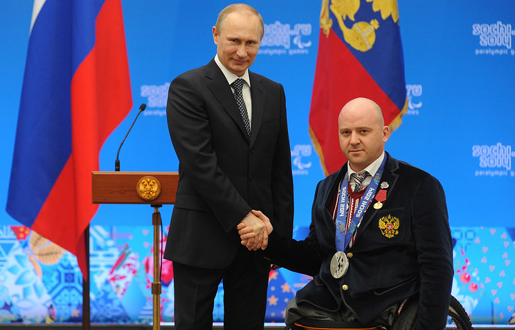 Vladimir Putin and ice sledge hockey athlete Ruslan Tuchin