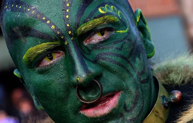 A participant poses on the second day of a carnival celebration in Macedonia