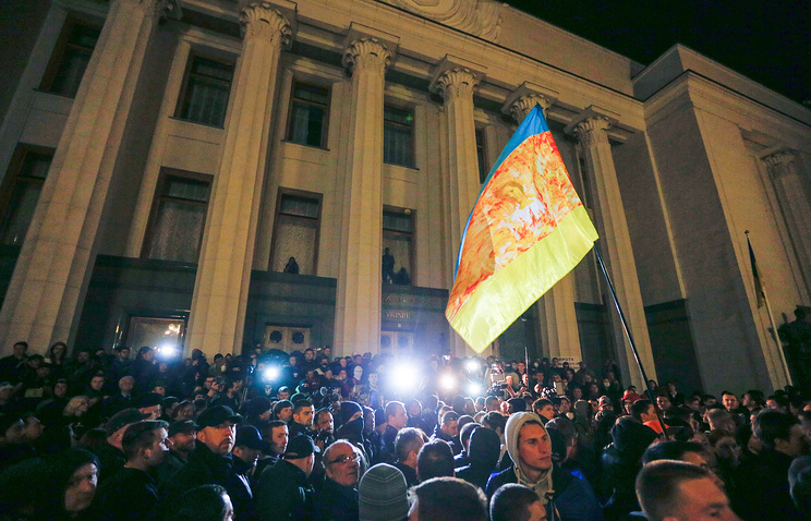Members and supporters of the Right sector rally near the Ukrainian Parliament building