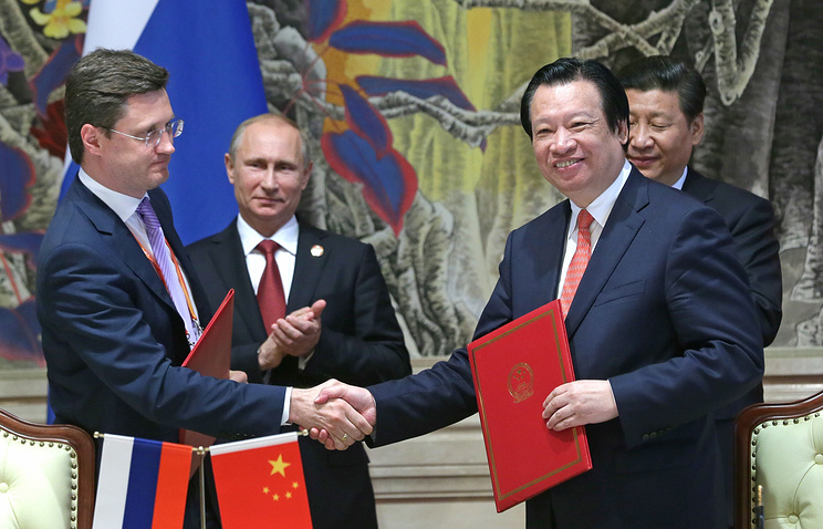The deal was signed in the presence of Russian President Vladimir Putin and his Chinese counterpart Xi Jinping