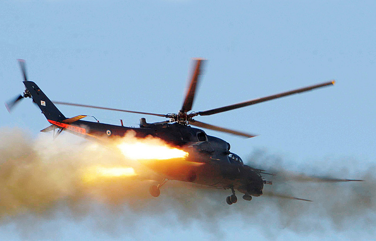 Russian-made Mi-35 helicopter fires missiles (archive)