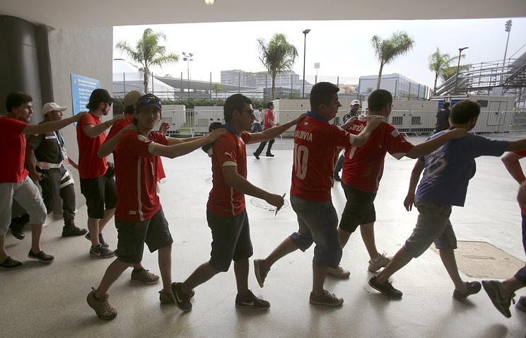Chilean fans who broke through the fence outside the Maracana