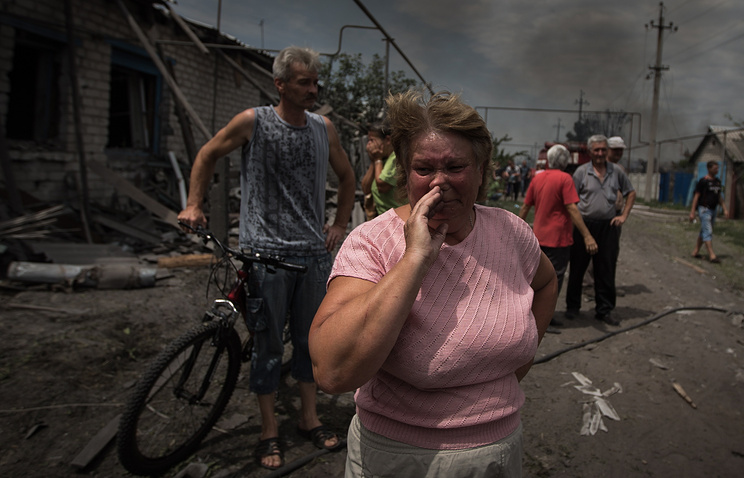 Local residents after an air strike carried out by Ukrainian armed forces on a settlement in Luhansk Region