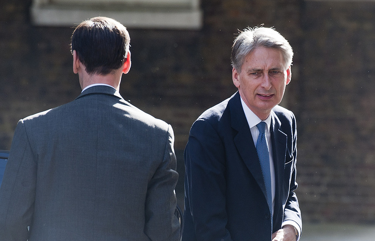 Britain's newly-appointed Foreign Secretary Philip Hammond (right)