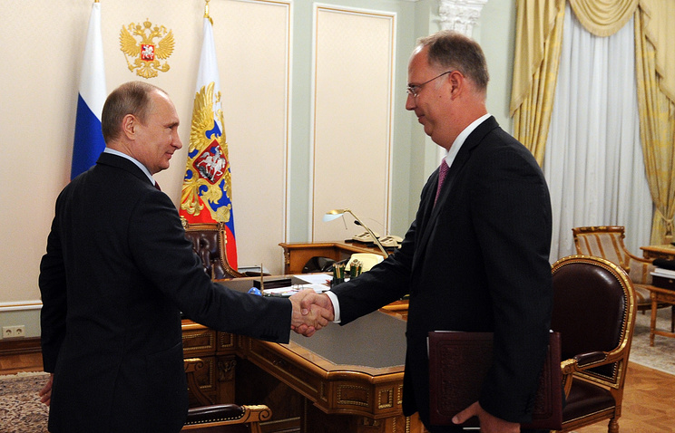 Russian Direct Investment Fund Director General Kirill Dmitriev (right) and Vladimir Putin