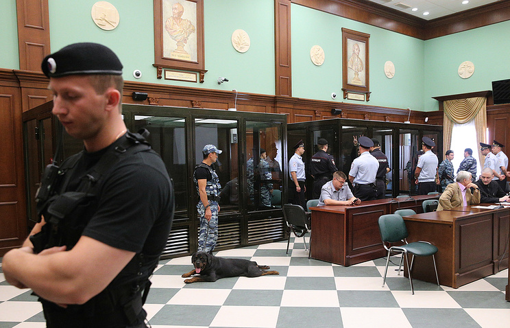 Police officers in a court room of the Moscow City Court ahead of the announcement of the sentence to Left Front opposition movement leader Sergei Udaltsov and opposition activist Leonid Razvozzhayev
