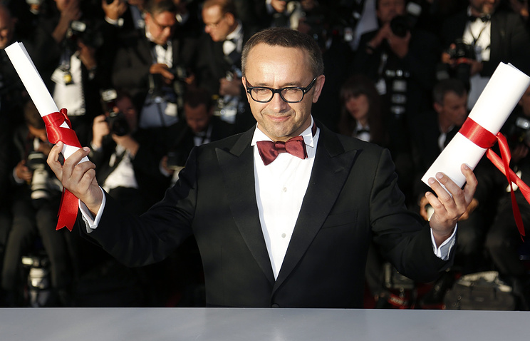 Russian director Andrey Zvyagintsev poses during the Award Winners photocall after he won the Best Screenplay award for his movie 'Leviathan' at the 67th annual Cannes Film Festival in Cannes, France, 24 May