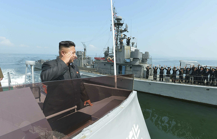North Korean leader Kim Jong-un salutes to military servicemen on a Navy ship (archive)