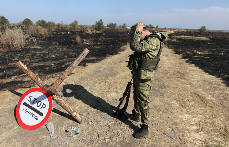 A Ukrainian soldier stands nears the Russian border