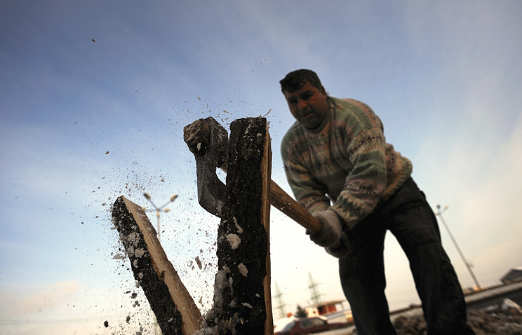 A man chops firewood in Sofia, Bulgaria