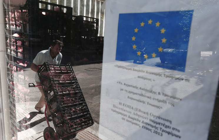 A man carries crates with peaches in Greece following Russia's embargo on food imports from the EU