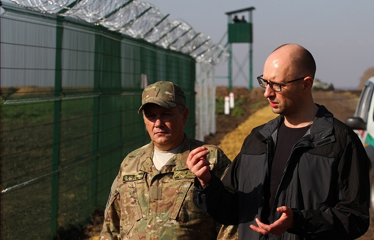 Prime Minister Arseny Yatsenyuk (right)