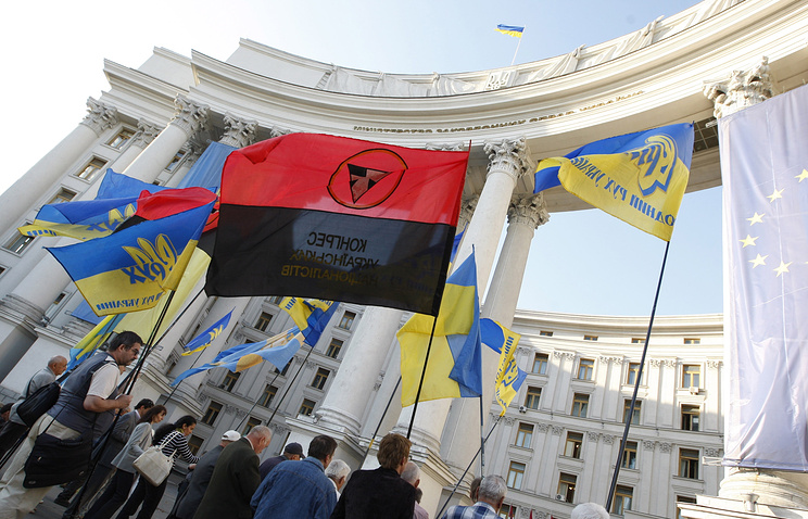Ukrainian national flags and Right Sector radical organization flags seen during a demonstration in Kiev