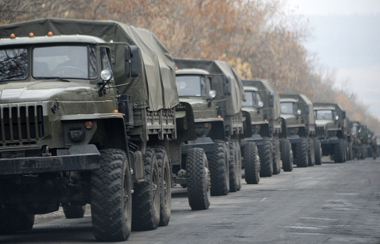 Unmarked military vehicles seen on a road near Donetsk Nov. 8