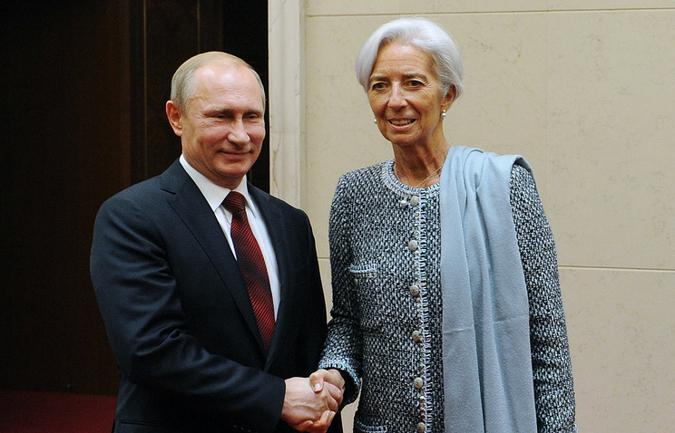 Vladimir Putin and Christine Lagarde