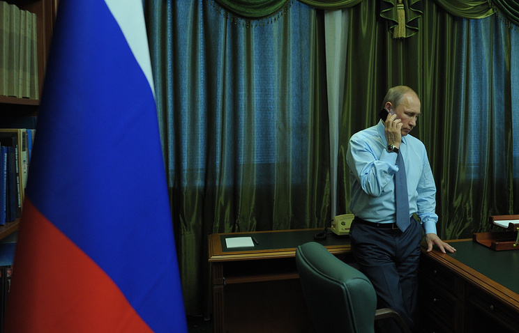 Vladimir Putin talking on the phone (archive)